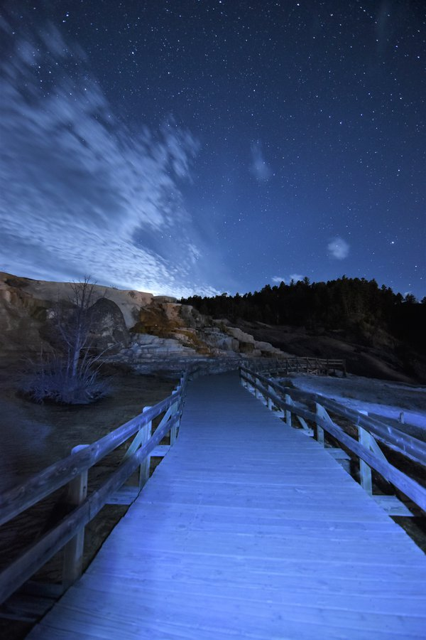 Moon set at the Boardwalk of Mammoth Hot Springs in Yellowstone thumbnail