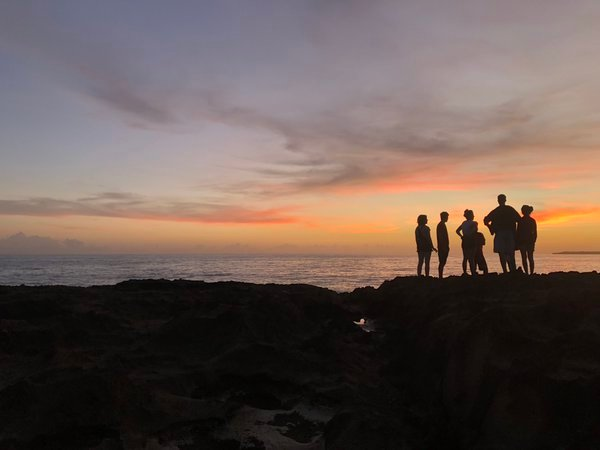 Friends gather at Mar Chiquita as the sun rises behind them. thumbnail