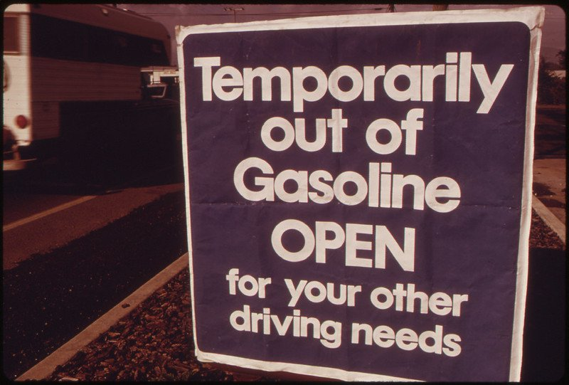"""Sign reading """"Temporarily out of gasoline. Open for your other driving needs"""""""