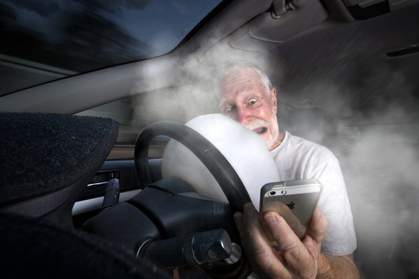 Staged example of a vehicle crash whilst on mobile phone thumbnail