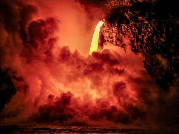 Lava pouring off a 60 ft cliff into the ocean. Big Island Hawaii thumbnail
