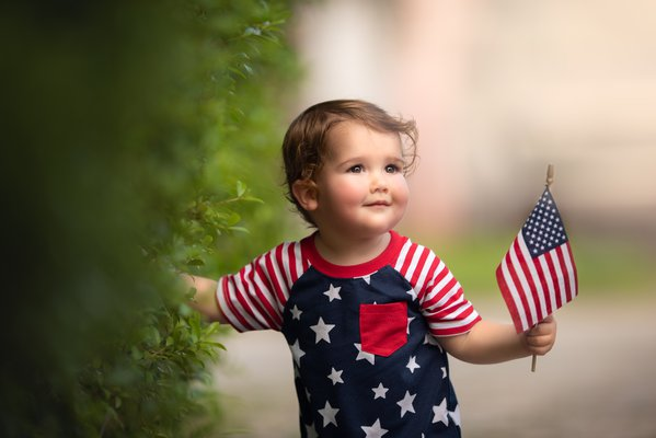 Baby boy holding American Flag for Independence Day  thumbnail