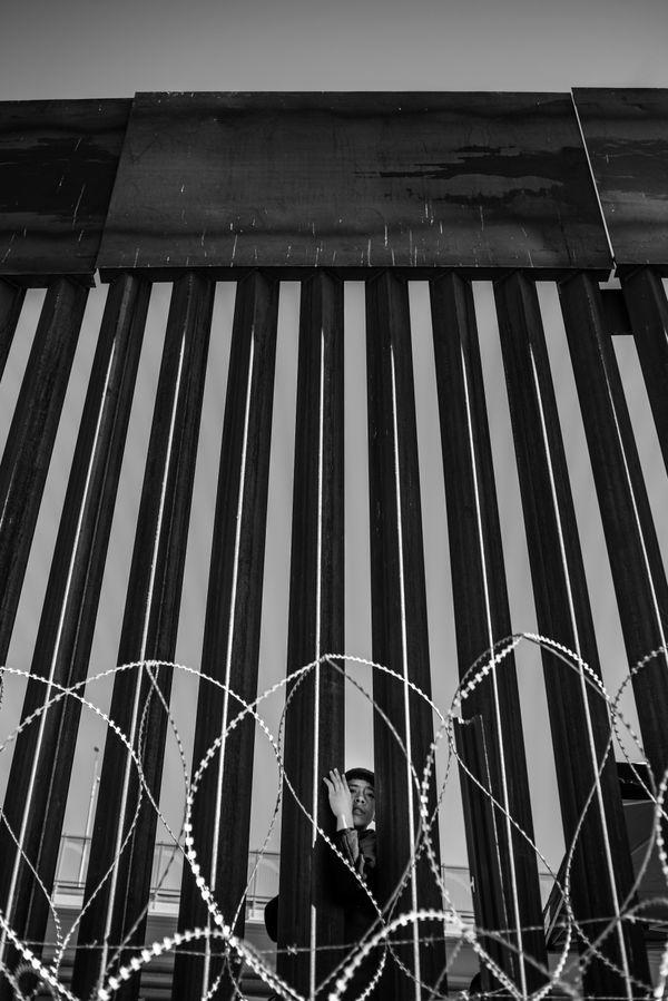 Young boy at the border wall thumbnail