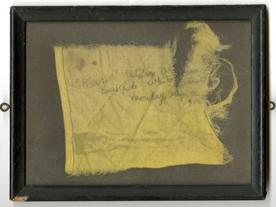 """Fragment from a flag that read """"'Kaiser' Wilson Banner East Gate White House Monday, August 13, 1917."""" The original banner read """"Kaiser Wilson Have You Forgotten Your Sympathy With the Poor Germans Because They Were Not Self-Governed? 20,000,000 American Women Are Not Self-Governed. Take the Beam Out of Your Own Eye"""""""