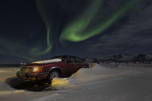 A beautiful aurora above a car thumbnail