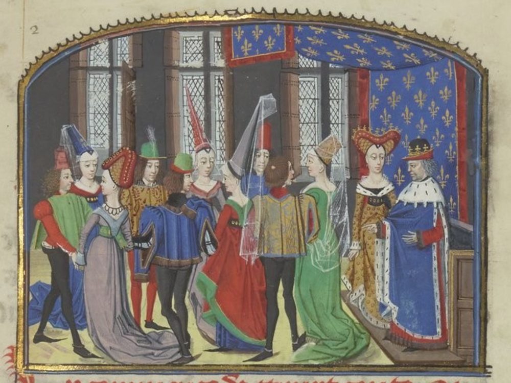 A colorful illuminated scene of young men and women, all in tall pointed hats and the men in tights and pointed shoes, gathered in front of two figures that appear to be a king and queen