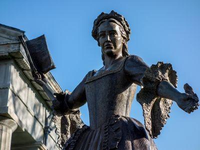 Bronze sculpture of Mercy Otis Warren stands in front of Barnstable County Courthouse, Massachusetts.