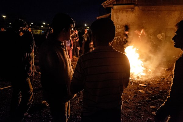 A group of refugees around the fire thumbnail