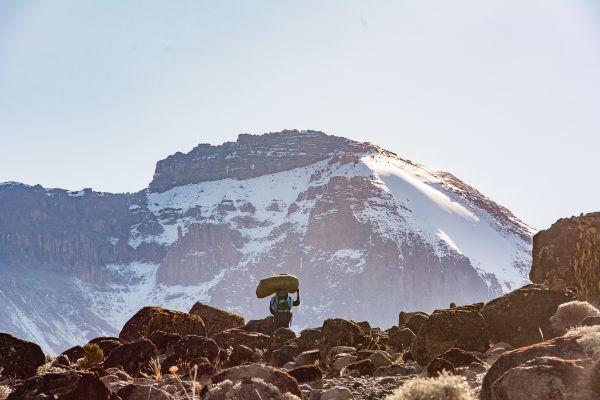 Porter Traversing Mt. Kilimanjaro thumbnail