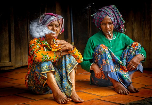 Two Stieng minority people women of Vietnam are resting after go to Feast of Tabernacles thumbnail