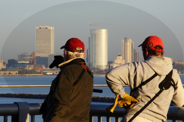 a pair of bird watchers, see something special across the bay. thumbnail