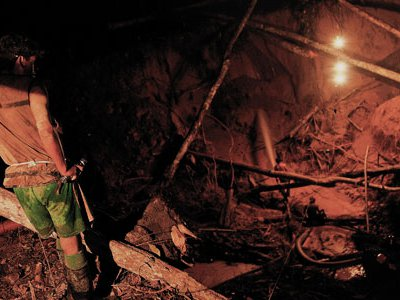 """To find flecks of gold, workers devour the rainforest floor with water cannons. """"There are a lot of accidents,"""" says one. """"The sides of the hole can fall away, can crush you."""""""