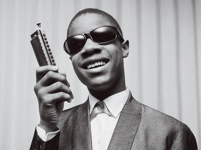 One of the most versatile harmonica players in pop history is Stevie Wonder, shown here in Paris in 1963 at age 13.