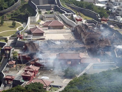 This aerial picture shows Shuri Castle after a fire ripped through the historic site in Naha, Japan's southern Okinawa prefecture, on October 31