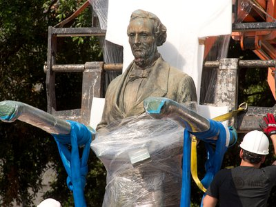A 1933 statue of Confederate leader Jefferson Davis is removed from University of Texas' South Mall after UT President Gregory Fenves cleared it to be placed in a campus museum.