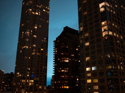 The night sky from the Upper West Side of Manhattan glows blue after mishap at Queens facility run by Con Edison.