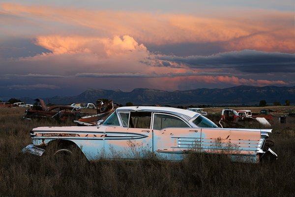 A classic american car rusts aways in the deserts of southwest colorado at sundown. thumbnail