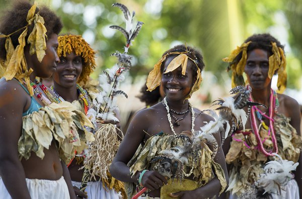 Village women enjoy a traditional dance in the Solomon Islands. thumbnail