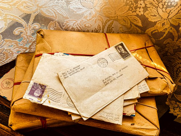 Unopened letters and packages and lace curtains thumbnail
