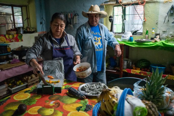 Husband and wife preparing dinner for impromptu guests in Lagunilla, Mexico. thumbnail