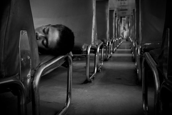 A homeless boy sleep inside the parking train in Kota Railway, Jakarta. thumbnail