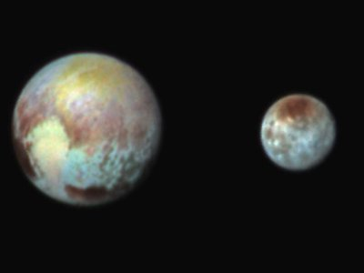 Exaggerating the colors on Pluto and Charon helps mission scientists see distinct terrains on each icy world.