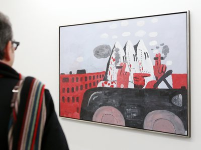 Many of Philip Guston's later works, including Riding Around (1969), depict distorted, cartoon-like figures performing everyday activities while wearing Ku Klux Klan robes.