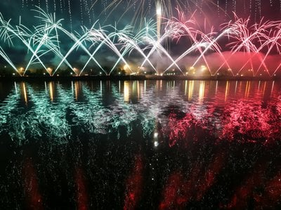 Fireworks go off over the Moskva River.