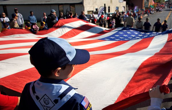 Boy Scouts carry the American flag in the Herndon Homecoming Parade. thumbnail