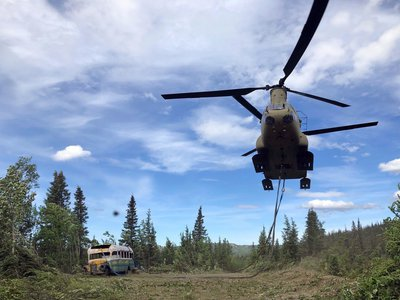 """The Alaska Army National Guard used a CH-47 Chinook helicopter to remove the bus featured in the book and film """"Into the Wild."""" The bus was removed due to public safety concerns. Hundreds of fans of the book and film had undertaken the dangerous pilgrimage to reach the bus's remote location, resulting in the deaths of two women."""