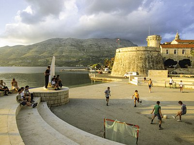 Youngsters play soccer near a fort at the port of Korčula, which once served as the arsenal of the Venetian Empire in the Adriatic.