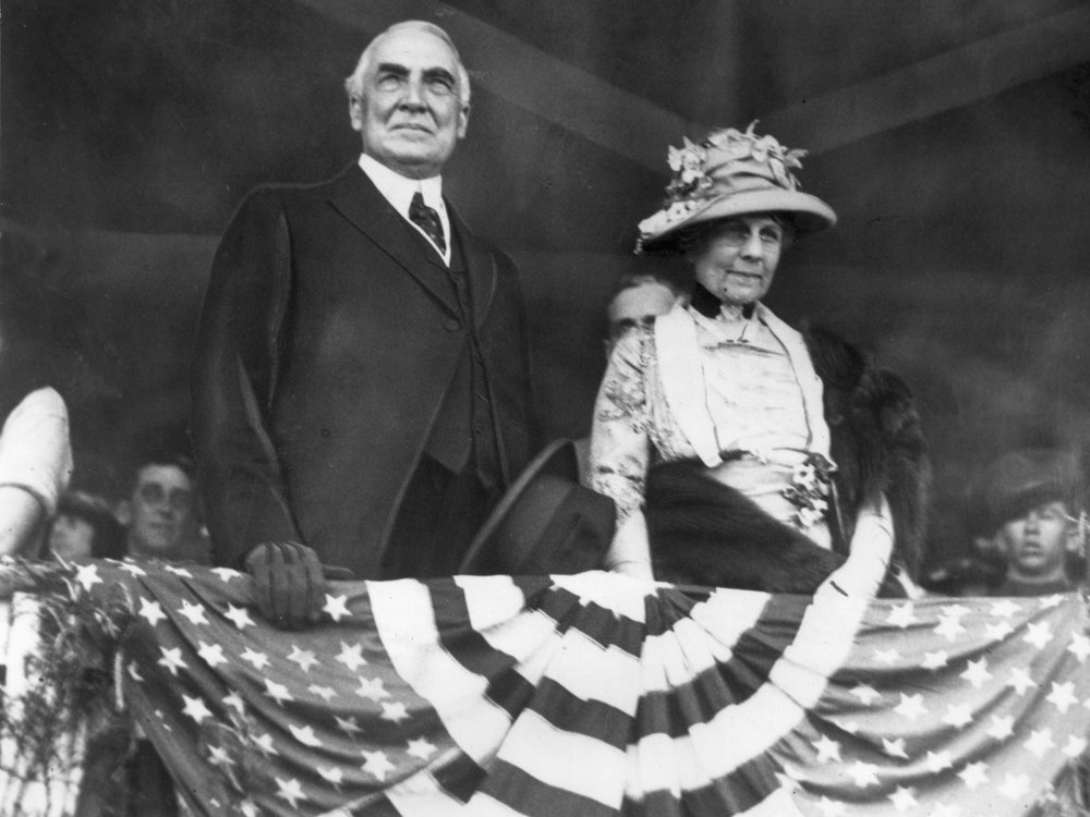 Warren Harding and his wife above patriot bunting