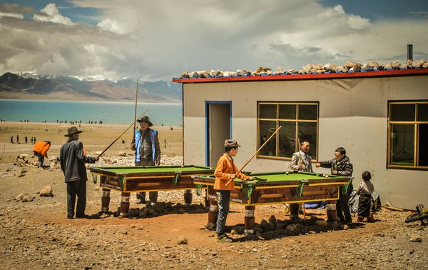 A group of locals playing billiard by the Namtso Lake in Tibet. thumbnail