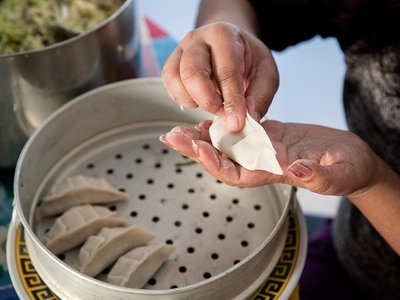 Fold the momo and pinch it closed.
