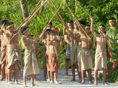 Members of Chamorro organizations, including the children from the Hurao Cultural Camp, perform a burial ceremony.