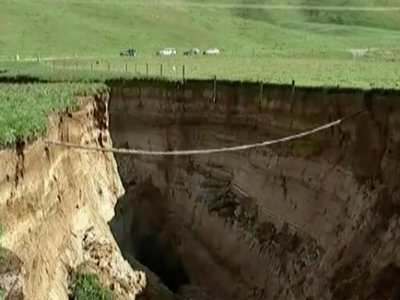 A spectacular sinkhole the length of two football fields and the depth of a six-story building has opened up on a New Zealand farm.