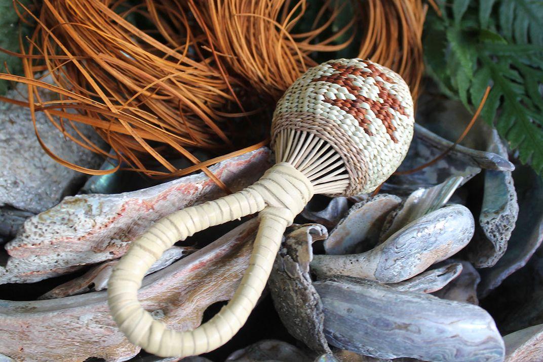 Closeup on a woven grass rattle.
