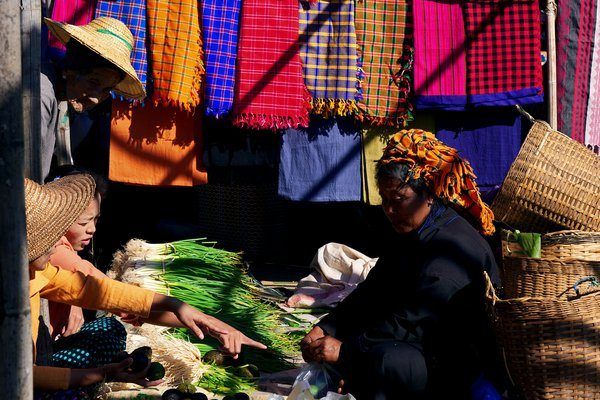 People in Colourful Market thumbnail
