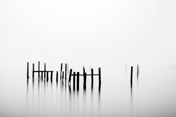 A long exposure on a foggy morning allowed the sky and water to become one. thumbnail