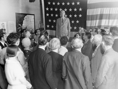 Upton Sinclair, noted author and Democratic nominee for Governor, pictured speaking to a group in his campaign headquarters shortly after his arrival in Los Angeles.