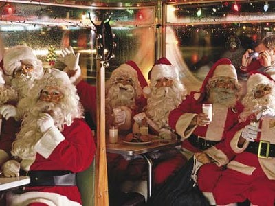 """""""Very seldom do a bunch of Santas get together,"""" says Jerry Clarke, the right-most Santa, who manages apartments by day."""