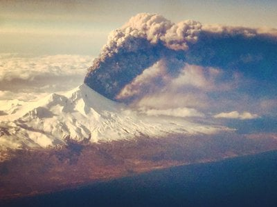A passenger aboard a commercial flight to Anchorage, AK snapped this picture of the volcano in action.