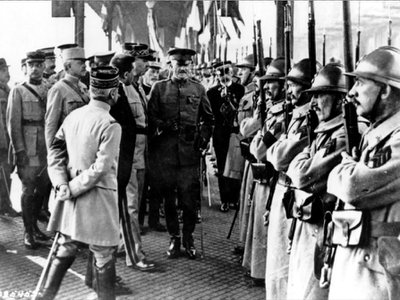 In this June 13, 1917 file photo, U.S. Army General John J. Pershing, center, inspects French troops at Boulogne, France