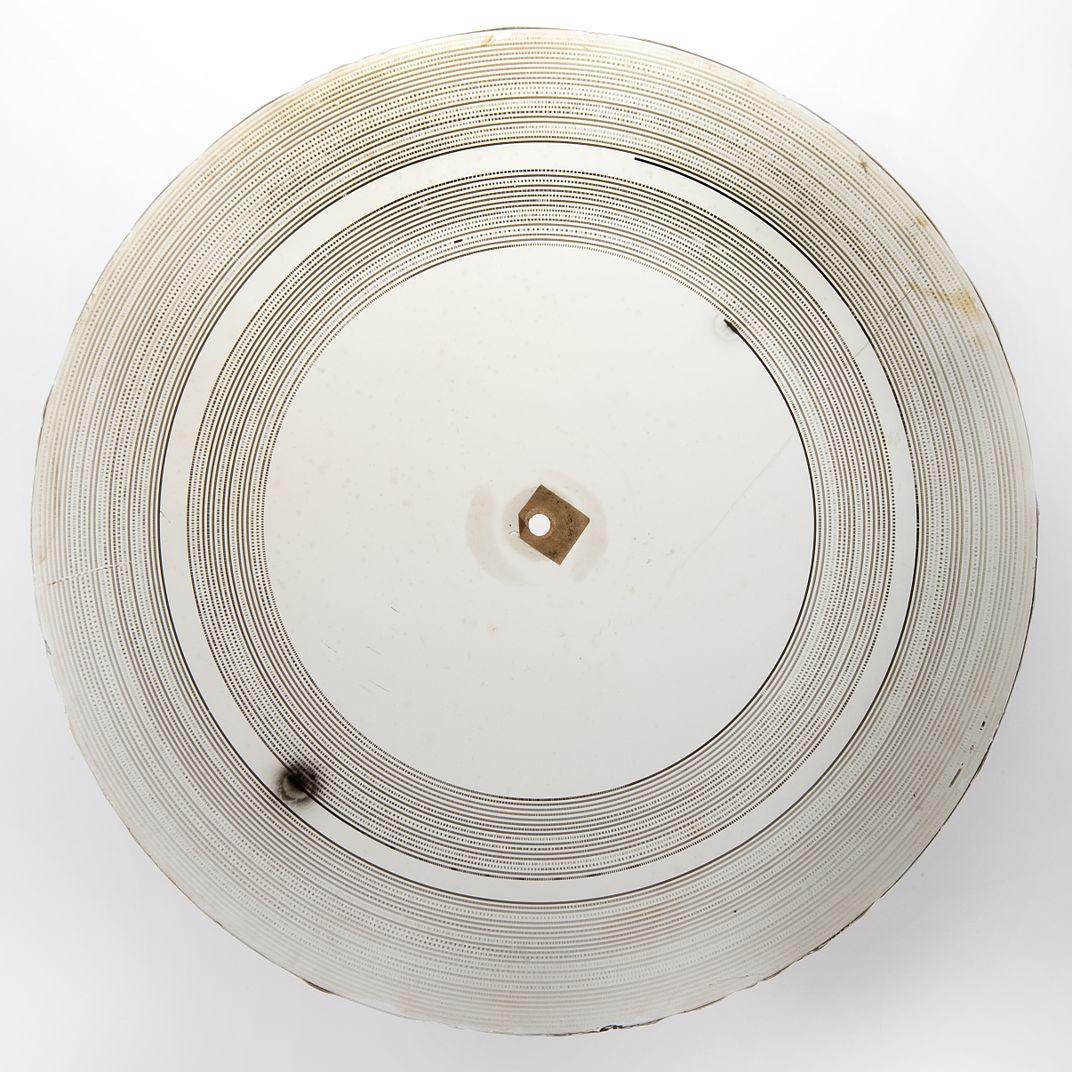 Photo: Rich Strauss, Smithsonian  Glass disc recording (March 11, 1885). Photo: Rich Strauss, Smithsonian