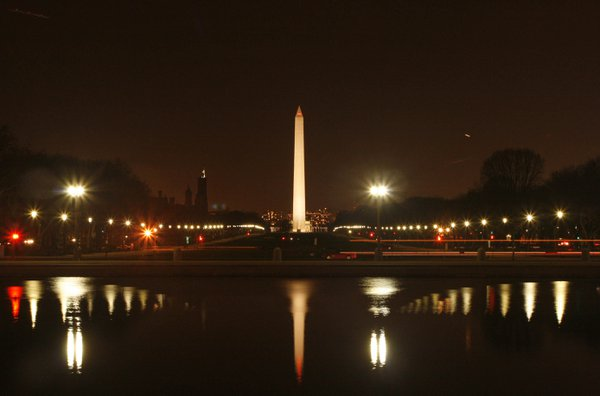 Lights emitted by the Washington Monument and the National Mall are mirrored by the Capitol Reflecting Pool thumbnail