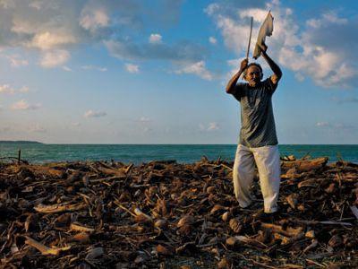 "Taíno leader Francisco ""Panchito"" Ramírez Rojas offers a prayer to the sea near Baracoa on Cuba's eastern coast."