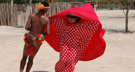 Two Wayuu dancers from La Guajira Province in northern Colombia perform a courtship dance.