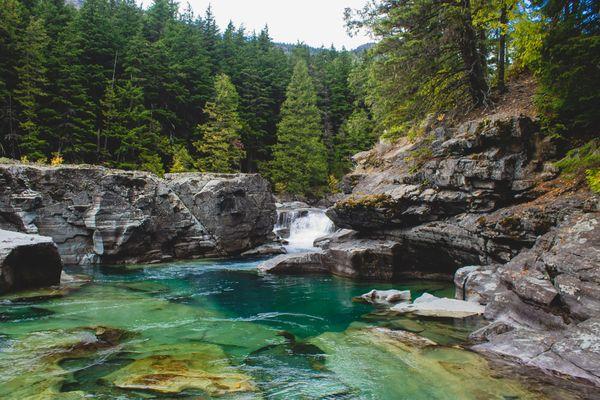 Blue pool in Glacier National Park thumbnail