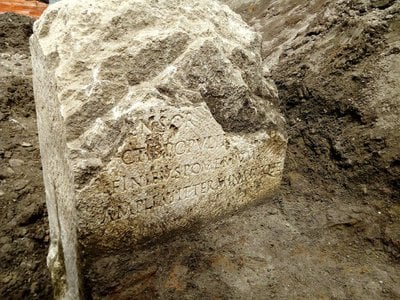 """The limestone slab's inscription states that Claudius """"extended and redefined the pomerium because he had increased the boundaries of the Roman people."""""""