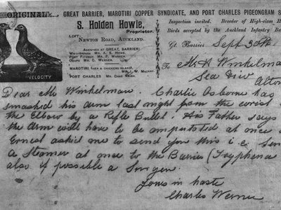 """A hasty 1900 pigeongram sent to H. Winkelmann by Charles Werner, a great Barrier Island resident. """"Dear Mr Winkelmann,"""" it reads, """"Charlie Soborne has smashed his arm last night from the wrist to the elbow by a rifle bullet. His father says that the arm will have to be amputated at once so Ernest asked me to send you this... send a steamer at once to the Barrier... also if possible a lawyer."""""""